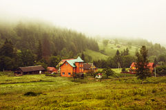 Morning fog in a mountain valley Stock Photography