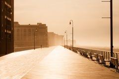 Morning fog on the ocean promenade Stock Photos