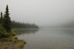 Morning fog over Cavell Lake in Canadian Rockies Royalty Free Stock Photography