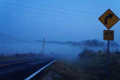 Morning fog over highway Stock Photography