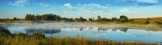 Morning fog over the lake Stock Photos