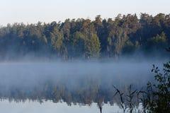 Morning fog over the lake Stock Photo