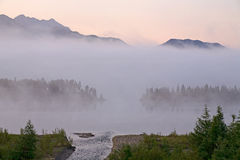 Morning fog over a mountain lake. Royalty Free Stock Images