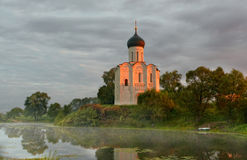 Morning fog over a pond near the temple of the Intercession on Nerli. Bogolyubovo Stock Images