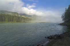 Morning fog over the river. Altai mountains, Russia. Royalty Free Stock Photos