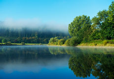 Morning fog over the river in sunshine Royalty Free Stock Images
