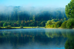 Morning fog over the river in  sunshine Royalty Free Stock Photos