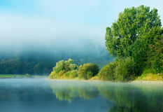 Morning fog over the river in sunshine Stock Images