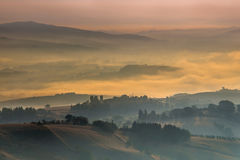 Morning Fog over Tuscany Hills, Italy Stock Images