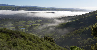 Morning fog over the valley. Royalty Free Stock Photo