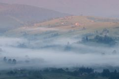 Morning fog over the village Royalty Free Stock Images