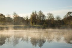 Morning fog over water. Morning fog over calm water Royalty Free Stock Photo