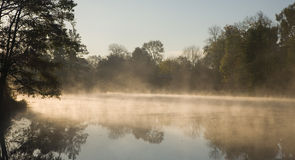 Morning fog over water. Morning fog over calm water Stock Images