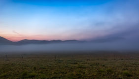 Morning fog at Piano Grande, Castelluccio, Umbria, Italy Royalty Free Stock Image