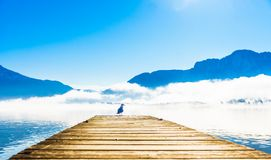 Morning fog on Pier of lake Mondsee and Alps in Austria. View on morning fog on Pier of lake Mondsee and Alps in Austria stock image