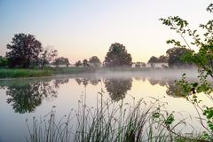 Morning fog on a quiet lake. Morning fog on a quiet beautiful lake stock photo