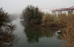 The morning in fog on  the river. With bridge and boat Stock Image
