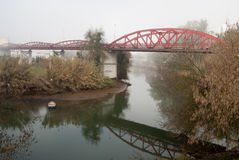 The morning in fog on  the river. With bridge and boat Stock Photo