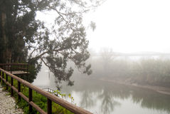 The morning in fog on  the river. With bridge and boat Stock Images