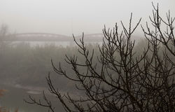 The morning in fog on  the river. With bridge and boat Royalty Free Stock Photography