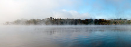 Morning fog. Rolls across a lake Stock Photo