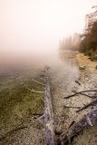 Morning fog rolls in over an Idaho mountain lake Royalty Free Stock Photo