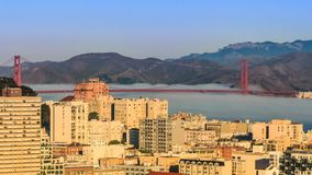 Morning Fog in San Francisco. Sunny morning in San Francisco with fog flowing under the Golden Gate Bridge stock video footage