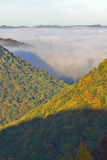 Morning fog at sunrise in autumn mountains of West Virginia in Babcock State Park Stock Photography