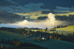 Morning fog in the valley in the Austrian Alps Royalty Free Stock Photos