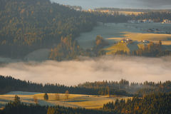 Morning fog in the valley in the Austrian Alps Royalty Free Stock Photo