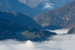 Morning fog in the valley in the Austrian Alps Stock Photo