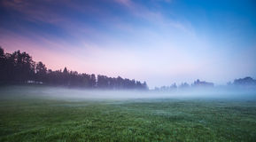 Morning fog in the valley with bright blue sky Royalty Free Stock Photo
