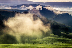 Morning fog in the valley between the hills Stock Photos
