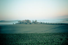 Morning fog view on farmhouse in Tuscany, Italy Royalty Free Stock Photography