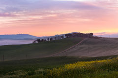Morning fog view on farmhouse in Tuscany, Italy Royalty Free Stock Photos