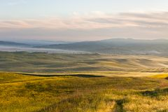 Morning fog view on fields Royalty Free Stock Images