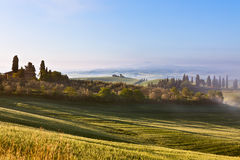 Morning fog view on Tuscan farmhouse Stock Images