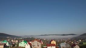 Morning fog in the village. Timelapse. stock video