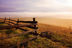 Morning fog and wooden fence