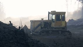 Morning, fog, the work of excavators and bulldozers on the construction site. Ground alignment.  stock video footage