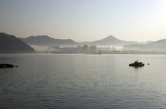 Morning foggy island town mountain sea Stock Photos
