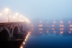 Morning french city mist. Morning mist in Toulouse, Pont Neuf (France Royalty Free Stock Photos