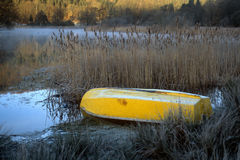 Morning Frost, boat and mist by lake Stock Photos