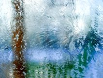 Morning frost on a window due to the freezing temperatures outside. Morning frost on a window due to the low temperatures outside royalty free stock image