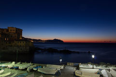 Morning in Genoa. Boats, house and sea during the sunrise Stock Photography