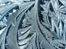 Morning Geometric Ice Patterns. Blue & white geometric ice patterns forming on a snowy, cold, blustery winter morning Royalty Free Stock Photo