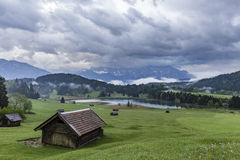 Morning at Geroldsee. View on Geroldsee in Bavaria from a hill with heavy clouds in the sky Stock Photo