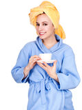 Morning girl in bathrobe drinking coffee Stock Photography