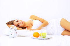 Morning. Girl resting in bed Stock Photography
