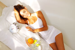 Morning, girl resting in bed Stock Photo
